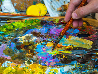 The hand of artist with a paintbrush