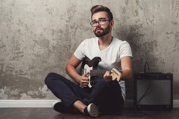 Stylish guy with a guitar