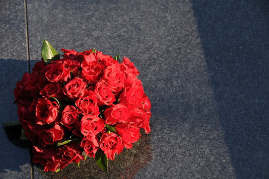 Red rosesbouquet  on the grave for all saints day on November 1.