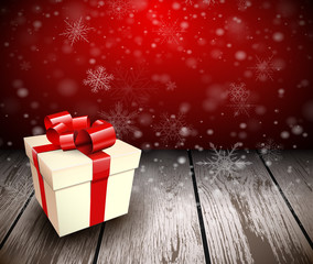 Christmas wooden background with gift box.