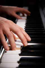 Close Up Of Hands Playing Electric Piano Keyboard