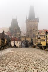 Prague, Charles Bridge and Mala Strana in a foggy day.