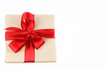 Gift box with red ribbon bow top view