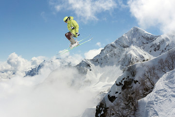 Flying skier on mountains. Extreme sport