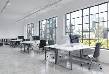 Workplaces in a bright modern loft open space office. Tables are equipped with modern computers; book shelves. New York panoramic view. A concept of a high quality consulting services. 3D rendering.