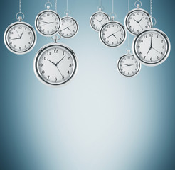 Several models of pocket watches which are hovering in the air. A concept of a value of time in business. Light blue background. 3D rendering.
