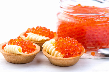 Tartlets with red caviar closeup. Gourmet food