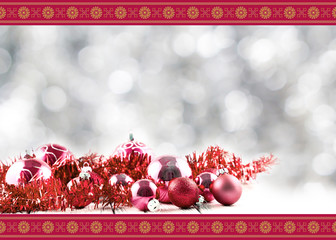 Greeting Christmas card with red balls and decorations on retro vintage white table isolated on white with red and golden ornament on blurred background