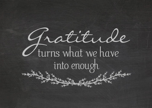 gratitude quote on dusty black chalkboard