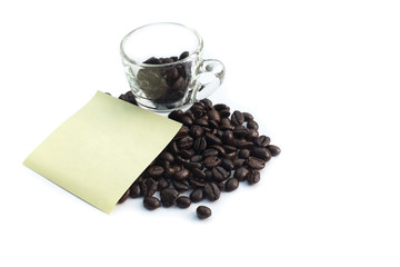 Coffee beans with shot glasses isolate on white background