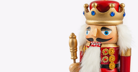 Traditional figurine christmas nutcracker wearing an old military style uniform