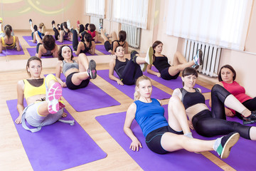 Sport, Fitness, Healthy Lifestyle Concepts. Group of Caucasain Women Having Athletic Excercises