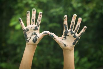 Dirty hands raising up.