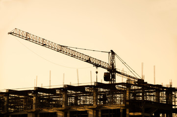 Iron crane in construction Site silhouettes