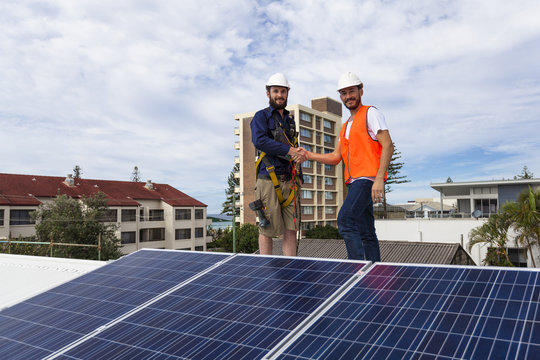 Solar panel technician and client