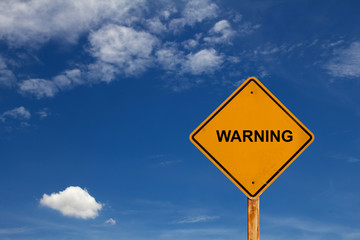 warning yellow traffic sign with blue sky