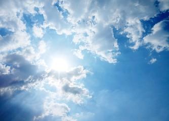 The sun on cloudy sky