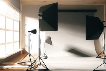 Empty photo studio with white background at sunrise