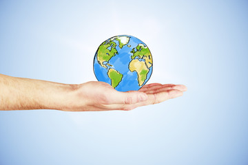 The whole world in your hand concept with hand and drawn earth p