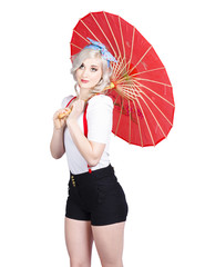 Smiling retro woman holding a red umbrella