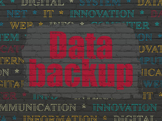 Information concept: Data Backup on wall background