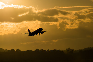 Foto op Textielframe Helicopter Silhouette plane take off in morning