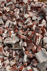 Discarded Red Bricks Are Piled High At Demolition Site