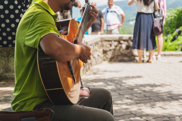 The musician man playing guitar, Emotion of happiness