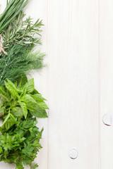 Fresh garden herbs on wooden table