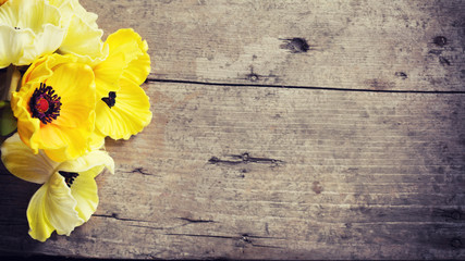 Flowers in yellow  colors on vintage wooden background.