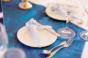 Elegant table set in soft blue for wedding