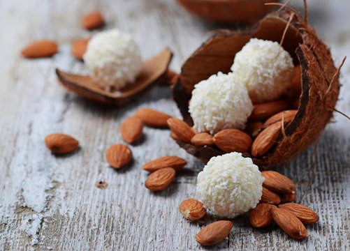 Coconut candies with almonds in coconut shell