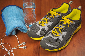 sport shoes towel and water
