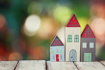 image of vintage wooden colorful houses decoration on wooden table in front of blured background