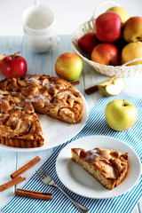 Homemade apple cake on blue wooden table