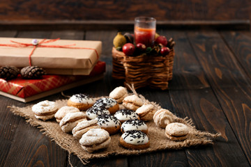 Chocolate cookies on the rustic wooden table.