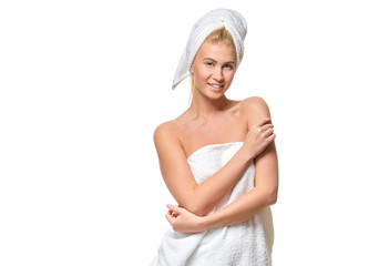 Young attractive woman with blue eyes in a towel