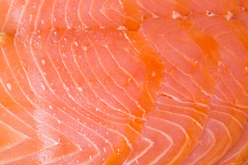 Macro of some slices of smoked salmon. Perfect as organic background.