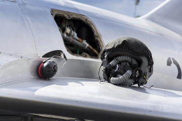 Detail of helmet and headphones on wing of jet fighter aircraft Mikoyan-Gurevich MiG-15