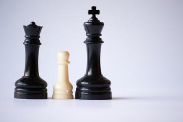 White pawn on a black monarchy