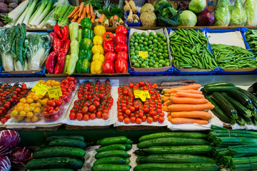 market with various colorful fresh fruits and vegetables. Farmer