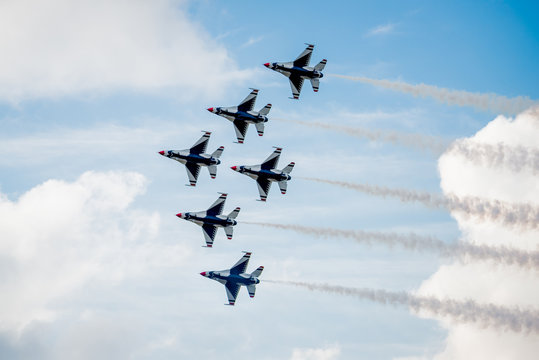 USAF F-16 Thunderbirds Flying Above the Clouds