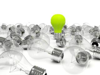 Green light bulb in a pile of bulbs