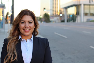 Image of beautiful Hispanic businesswoman while standing on the road