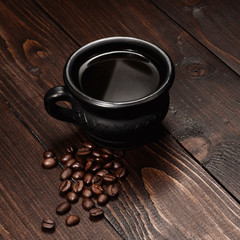 Cup of coffee with grains coffee