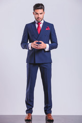 confident business man posing standing and touching palms