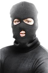 Face of a burglar wearing a ski mask or balaclava