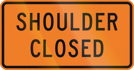 New Zealand road sign: Road shoulder closed.