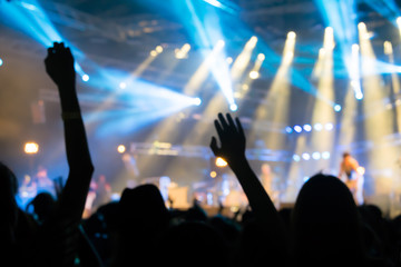 Blurred background : Bokeh lighting in outdoor concert with cheering audience