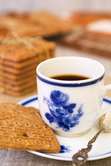 Cup of coffee with a typical Dutch speculaas cookie